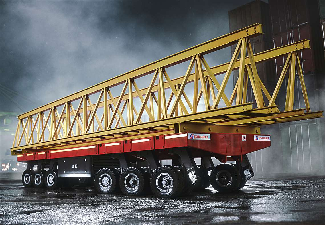 Six axle module of red PowerHoss carrying a yellow lattice section