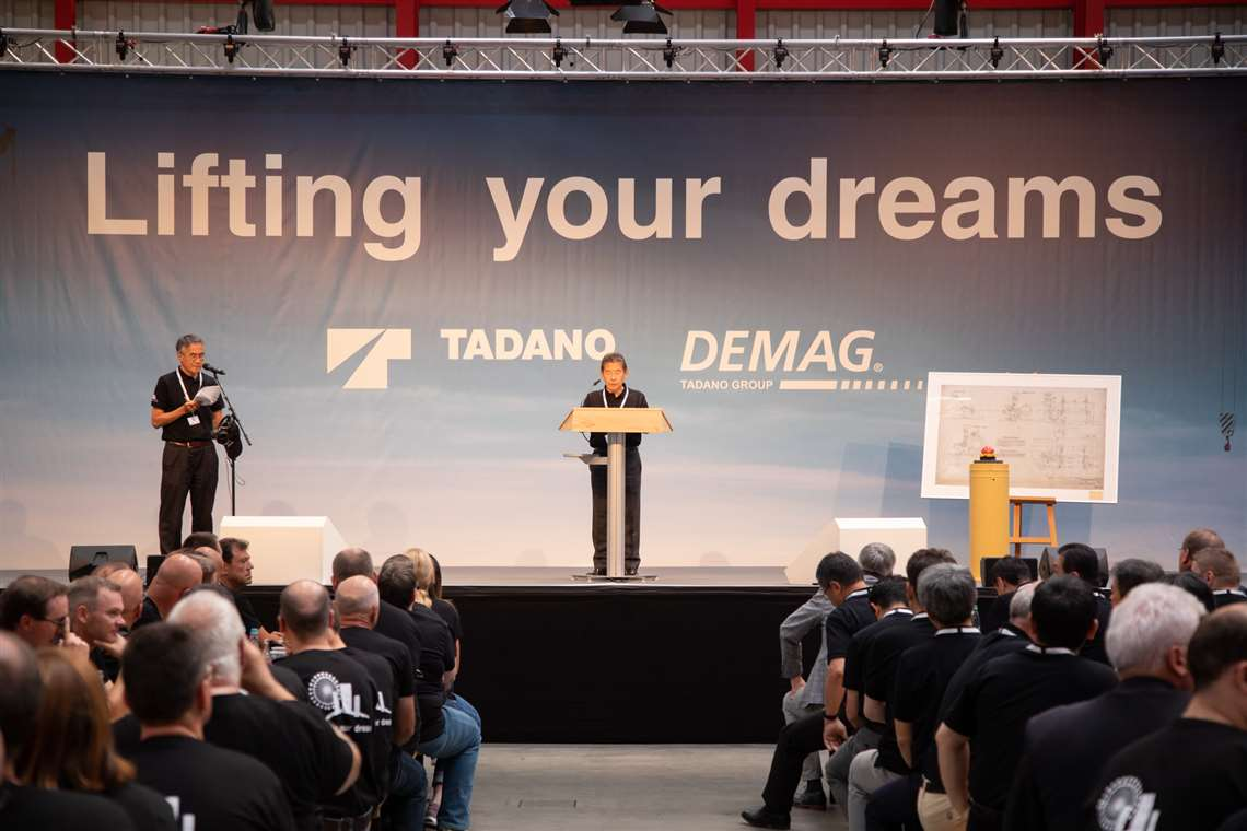 Koichi Tadano makes a speech on 01 August 2019, the first day of Tadano's ownership of Demag