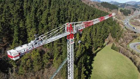 Aerial view of the new Jaso J800.48 low top tower crane on test in Spain, painted red and white