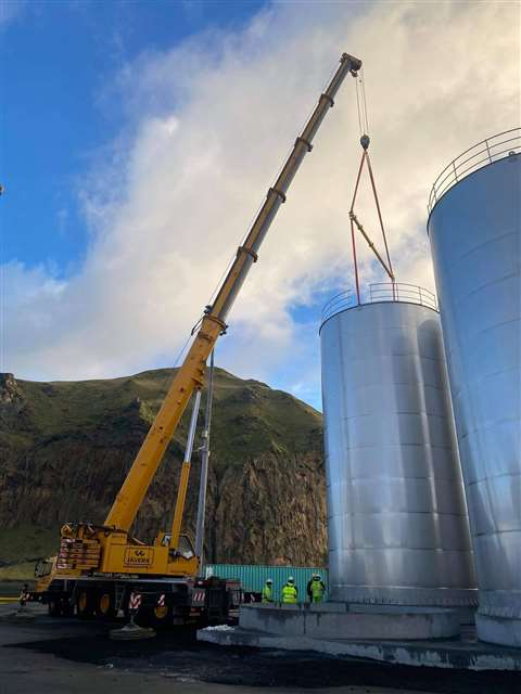 One of the four storage tanks being placed into position